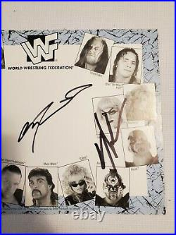 1997 WWF Superstar Promo Mat Autographed By Road Warriors Hawk and Animal