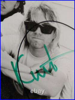 Nirvana DGC Promo Picture signed by Kurt Cobain, Dave and Krist